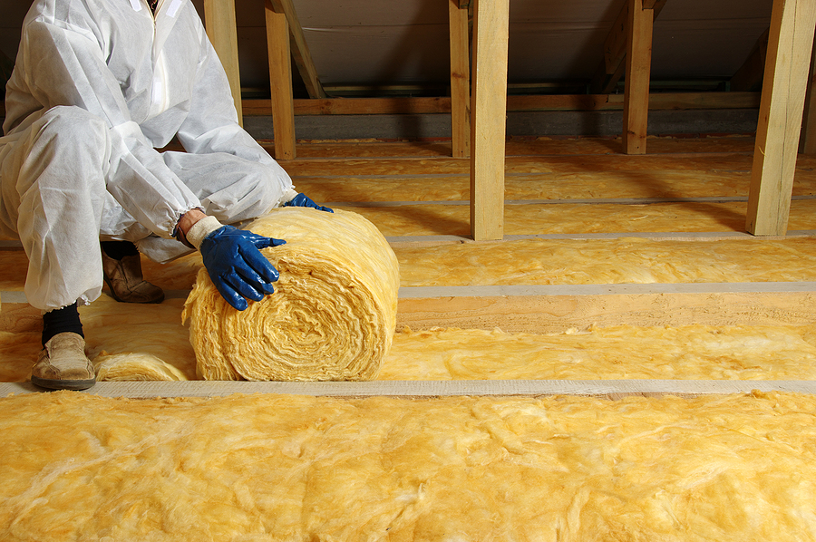 House attic insulation - construction worker installing glass wool - Insulation installation in Fremont CA | Residential & Commercial Insulation near me