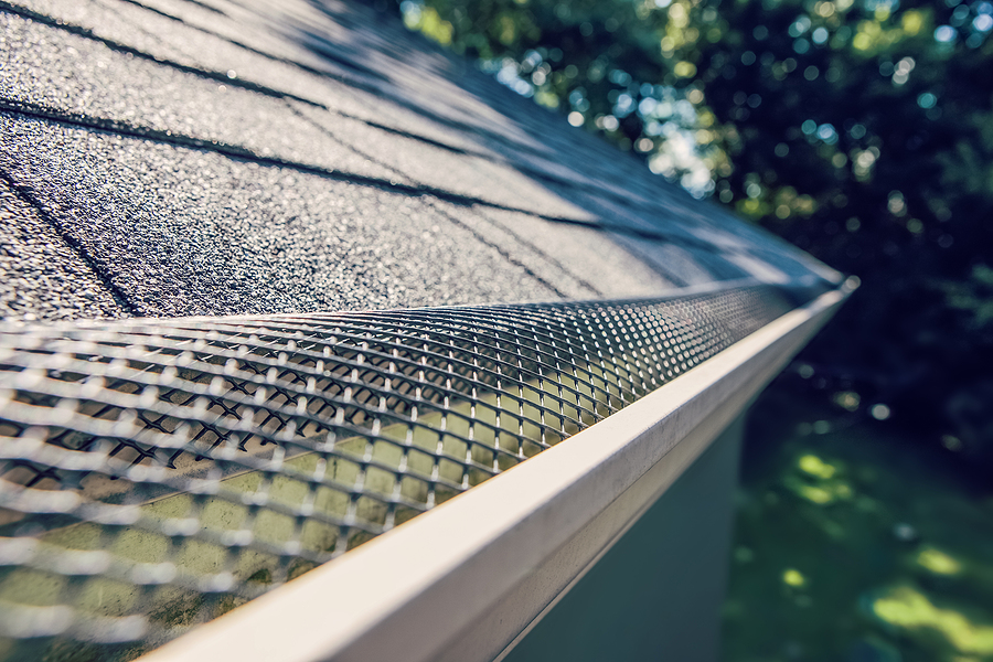 Gutter guard installation in Walnut Creek CA | Attic Insulation Service Fiberglass Insulation - guard over gutter trough on a roof