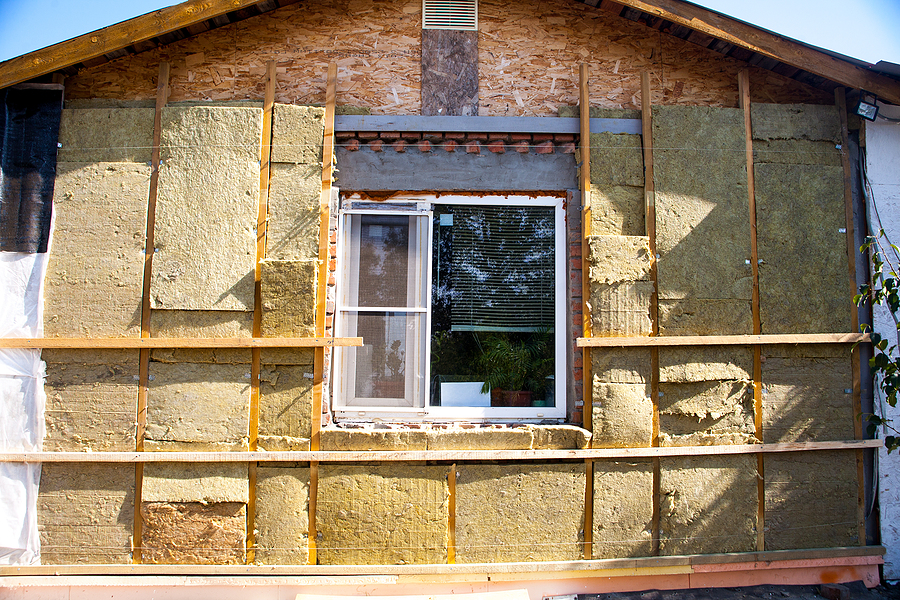 Insulation installation in Orinda CA | How much does it cost to insulate a house, attic, wall warming the walls of a stone house with a stone wool heater. Ecological insulation of rooms with building a house. Installation of cellulose thermal insulation in the wall of the frame house