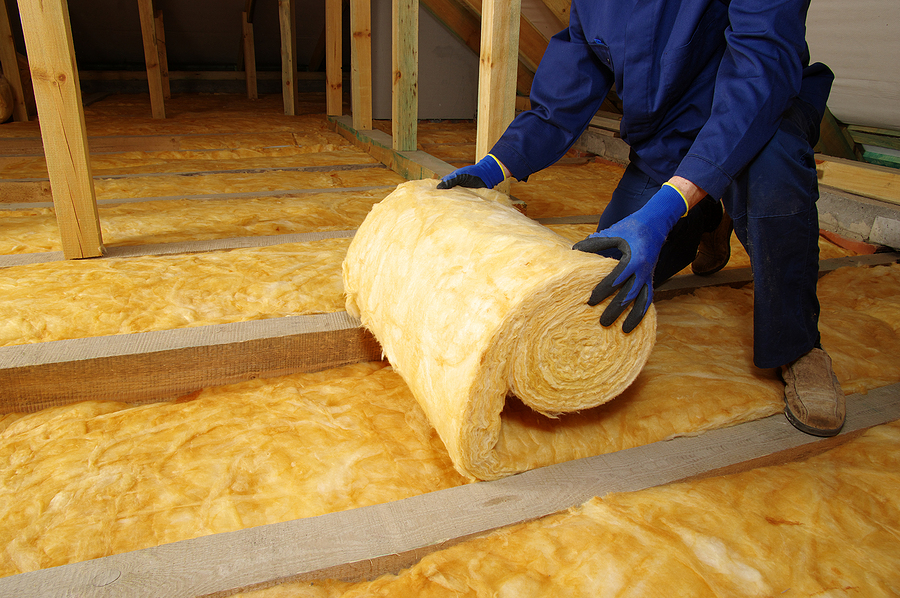 Worker insulate the attic with mineral wool - Old Insulation removal in Berkeley CA | Residential & Commercial Insulation near me